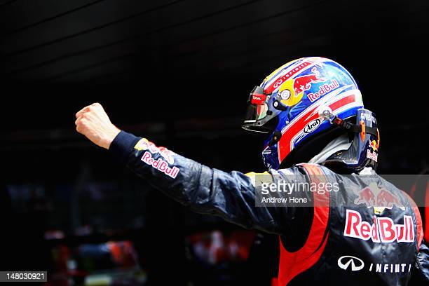 Mark Webber of Australia and Red Bull Racing celebrates in parc ferme after winning the British Grand Prix at Silverstone Circuit on July 8 2012 in...