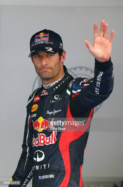 Mark Webber of Australia and Red Bull Racing celebrates in parc ferme after taking pole position during qualifying for the Korean Formula One Grand...