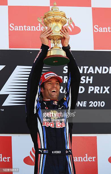 Mark Webber of Australia and Red Bull Racing celebrates on the podium after winning the British Formula One Grand Prix at Silverstone on June 11 in...