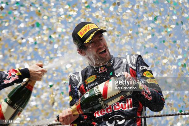 Mark Webber of Australia and Red Bull Racing celebrates on the podium after winning the Brazilian Formula One Grand Prix at the Autodromo Jose Carlos...