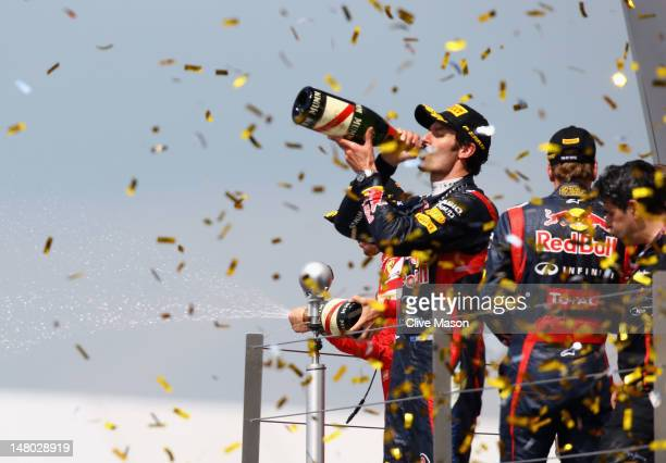 Mark Webber of Australia and Red Bull Racing celebrates on the podium after winning the British Grand Prix at Silverstone Circuit on July 8 2012 in...
