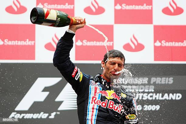 Mark Webber of Australia and Red Bull Racing celebrates on the podium after winning the German Formula One Grand Prix at Nurburgring on July 12 2009...