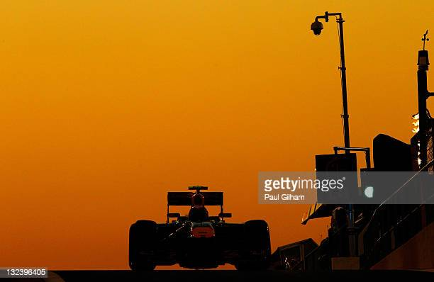 Mark Webber of Australia and Red Bull Racing drives down the pitlane during qualifying for the Abu Dhabi Formula One Grand Prix at the Yas Marina...