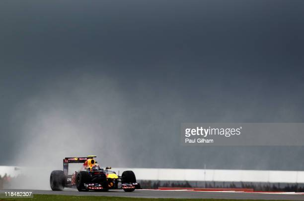 Mark Webber of Australia and Red Bull Racing drives during practice for the British Formula One Grand Prix at the Silverstone Circuit on July 8 2011...