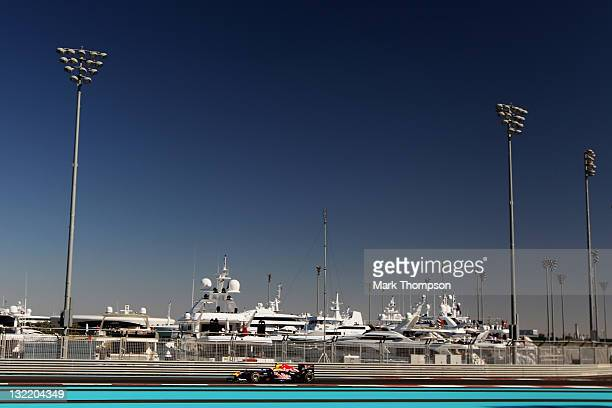 Mark Webber of Australia and Red Bull Racing drives during practice for the Abu Dhabi Formula One Grand Prix at the Yas Marina Circuit on November 11...