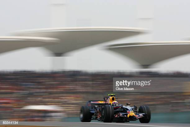 Mark Webber of Australia and Red Bull Racing drives during the Chinese Formula One Grand Prix at the Shanghai International Circuit on October 19,...
