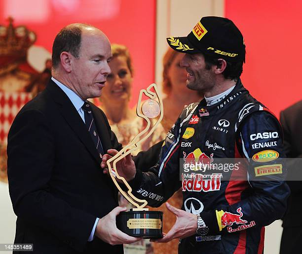 Mark Webber of Australia and Red Bull Racing is congratulated by Prince Albert II of Monaco after winning the Monaco Formula One Grand Prix at the...