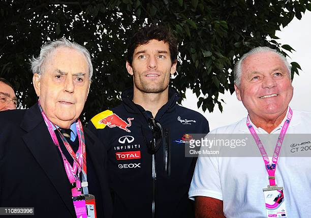 Mark Webber of Australia and Red Bull Racing is seen with former F1 World Champions Sir Jack Brabham and Alan Jones before qualifying for the...