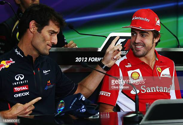 Mark Webber of Australia and Red Bull Racing jokes with Fernando Alonso of Spain and Ferrari at the drivers press conference during previews for the...