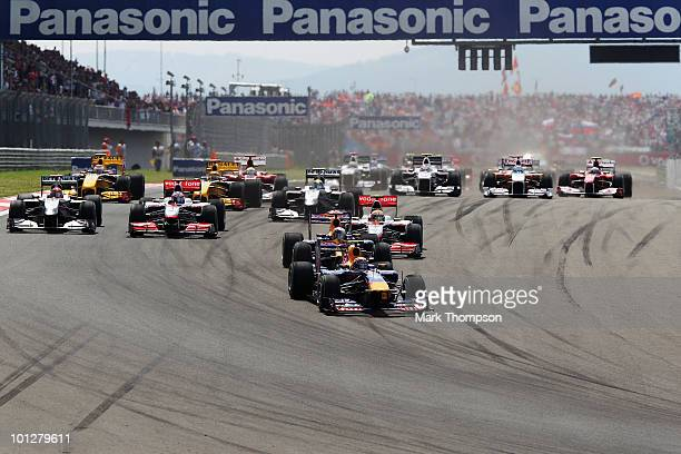 Mark Webber of Australia and Red Bull Racing leads the field into the first corner at the start of the Turkish Formula One Grand Prix at Istanbul...