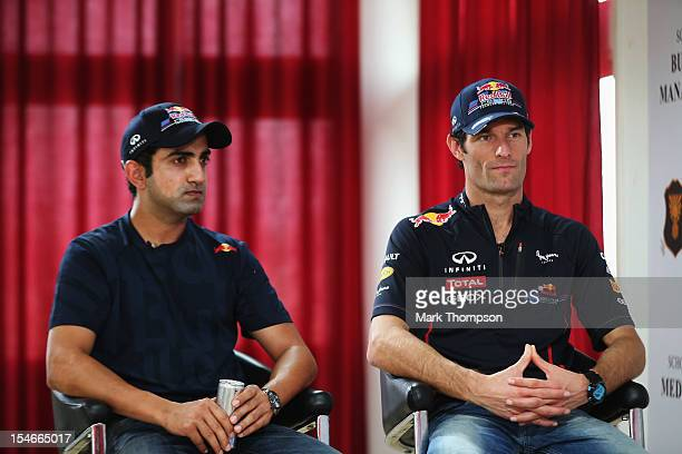 Mark Webber of Australia and Red Bull Racing meets Indian cricketer Gautam Gambhir during previews for the Indian Formula One Grand Prix on October...