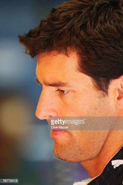 Mark Webber of Australia and Red Bull Racing prepares to drive in the warm up session prior to qualifying for the Belgian Formula One Grand Prix at...