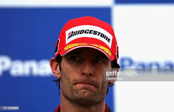 Mark Webber of Australia and Red Bull Racing reacts on the podium after finishing third during the Turkish Formula One Grand Prix at Istanbul Park on...