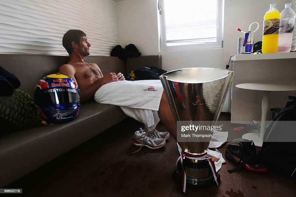 Mark Webber of Australia and Red Bull Racing relaxes in his changing room after ending up in the harbour while celebrating his victory in the Monaco Formula One Grand Prix at the Monte Carlo Circuit on May 16, 2010 in Monte Carlo, Monaco.