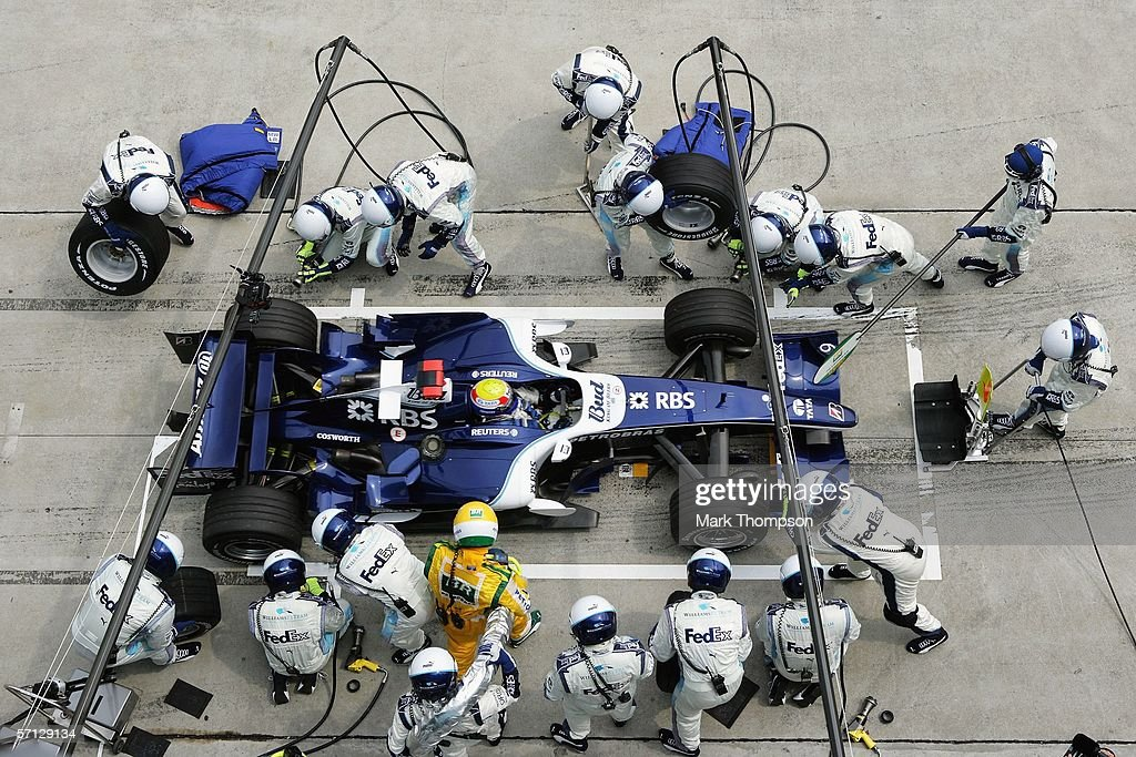 Mark Webber of Australia and Williams makes a pit stop during the Malaysian Formula One Grand Prix at the Sepang Circuit on March 19, 2006, in Kuala Lumpur, Malaysia.