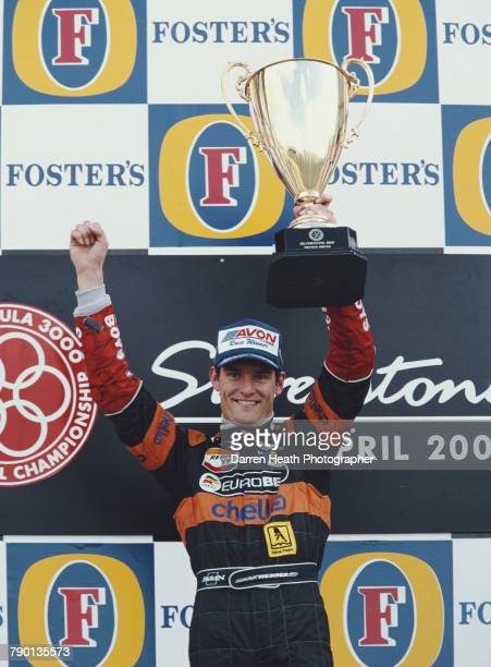 Mark Webber of Australia driver of the European Arrows F3000 Team Lola T99/50Zytek holds the trophy after winning the FIA International Formula 3000...