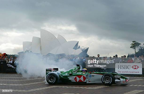 Mark Webber of Jaguar Racing F1 team and Australia shows off the power of his car during a Jaguar promotional competition at Circular Quay March 2,...