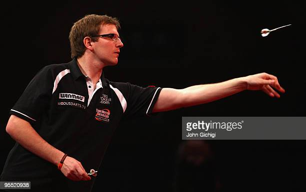 Mark Webster of Wales in action against Co Stompe of Netherlands during the Quarter Finals of the 2010 Ladbrokescom World Darts Championships at...