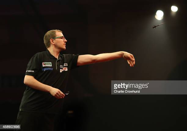 Mark Webster of Wales in action during his second round match against John Henderson of Scotland during the Ladbrokescom World Darts Championship on...