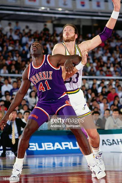 Mark West of the Phoenix Suns boxes out against Mark Eaton of the Utah Jazz during a game played on November 2 1990 at the Tokyo Metropolitan...