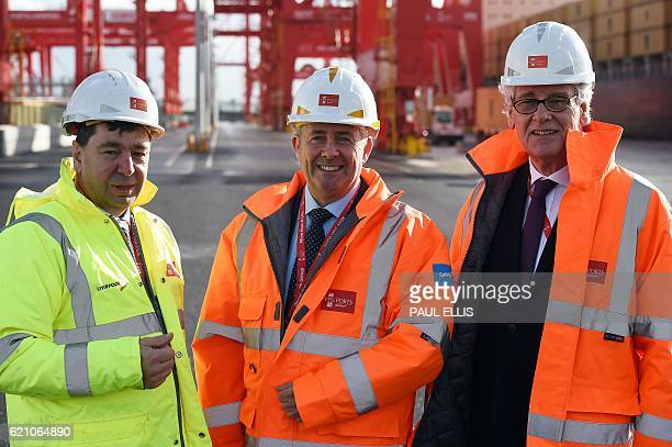 Mark Whitworth Chief executive of Peel Ports talks with British International trade minister Liam Fox and Tom Allison Chairman of Peel Ports take...