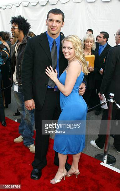 Mark Wilkerson and Melissa Joan Hart during The 30th Annual American Music Awards Arrivals at Shrine Auditorium in Los Angeles California United...