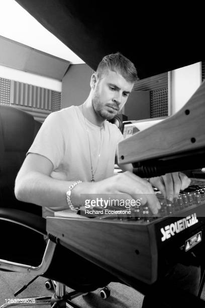 Mark Wilkinson English record producer DJ and remixer using a Sequential Prophet 6 analogue synthesizer United Kingdom 2018