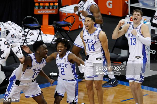 Mark Williams, DJ Steward, Jordan Goldwire, and Joey Baker of the Duke Blue Devils react following a basket during the second half of their first...