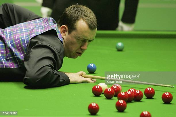Mark Williams eyes his next shot during his Quarter Final match against Ronnie O'Sullivan during the 888com World Championship at the Crucible...