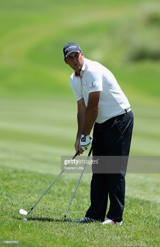 Mark Williams of South Africa is between clubs for his second shot into the ninth green during the first round of the Alfred Dunhill Championship at Leopard Creek Country Golf Club on December 13, 2012 in Malelane, South Africa.