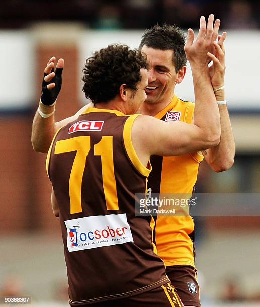 Mark Williams of the Hawks is congratulated by Adem Yze during the VFL 1st Elimination Final between the Box Hill Hawks and the Geelong Cats at Teac...