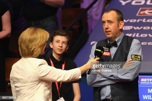 Mark Williams of Wales are being interviewed by Hazel Irvine and BBC after he won the tournament during day seventeen of World Snooker Championship...