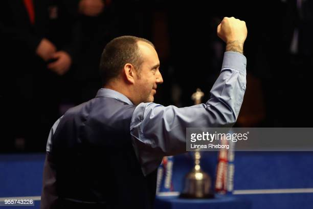 Mark Williams of Wales celebrates when realising he has won the tournament during the fourth session of the final against John Higgins of Scotland...