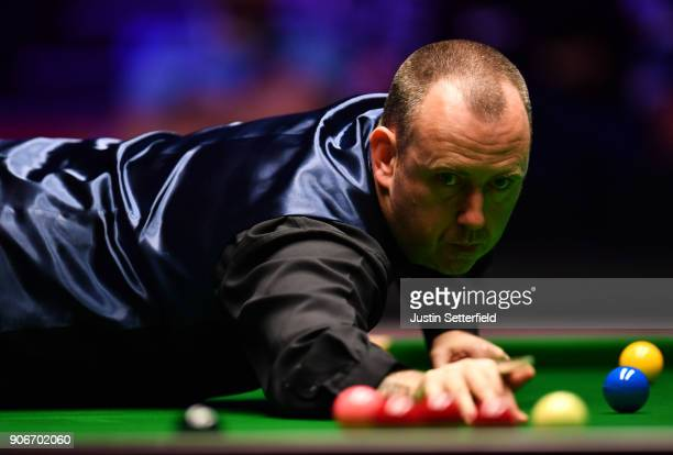 Mark Williams of Wales in action during his match against Kyren Wilson of England during The Dafabet Masters on Day Five at Alexandra Palace on...
