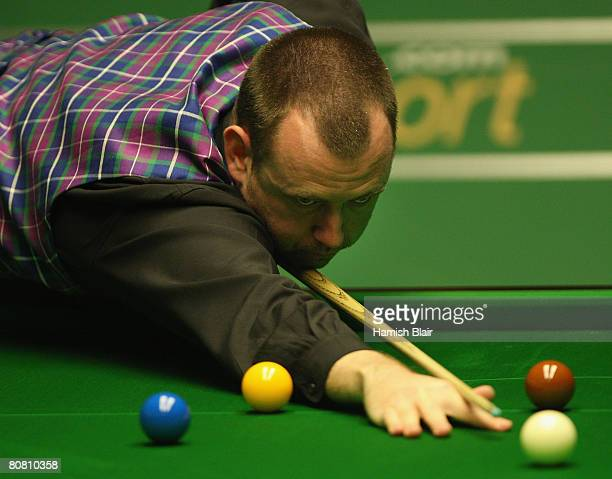 Mark Williams of Wales in action during his match against Mark Davis of England during day three of the 888com World Snooker Championships at the...