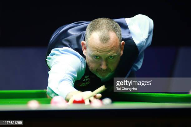 Mark Williams of Wales plays a shot in the semifinal match against Hossein Vafaei of Iran on Day six of Evergrande 2019 World Snooker China...