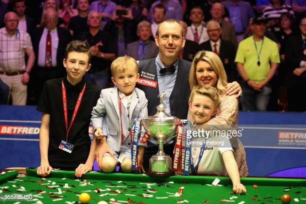 Mark Williams of Wales pose for a picture with his family and with his trophy after winning the tournament during day seventeen of World Snooker...