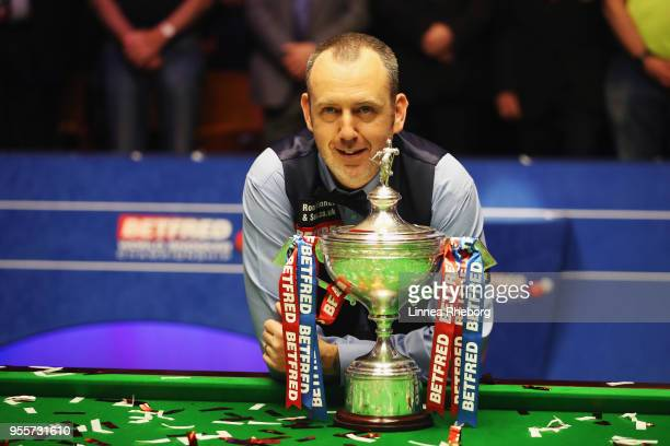 Mark Williams of Wales pose for a picture with his trophy during day seventeen of World Snooker Championship after winning the tournament at Crucible...