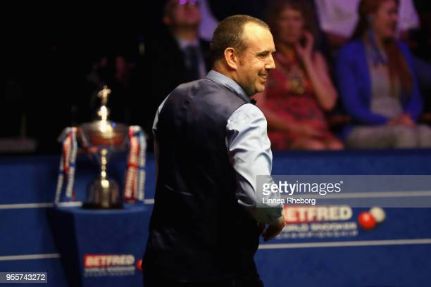 Mark Williams of Wales reacts during the fourth session of the final against John Higgins of Scotland during day seventeen of World Snooker...