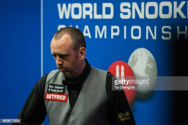Mark Williams of Wales reacts in the quarterfinal match against Ali Carter of England during day eleven of the World Snooker Championship at Crucible...