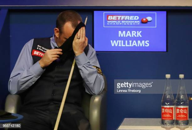 Mark Williams of Wales reacts when realising he has won the tournament during the fourth session of the final against John Higgins of Scotland during...