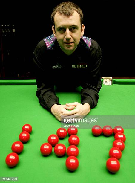 Mark Williams poses after getting a maximum 147 break during his first round match against Robert Milkins at the Embassy World Snooker Finals at the...