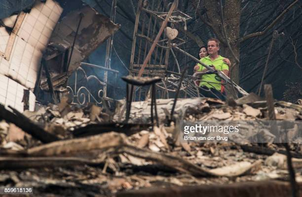 Mark Williams right and friend Norina Wong left look over the destruction in their friends' neighborhood off Fountaingrove Parkway near the Hilltop...