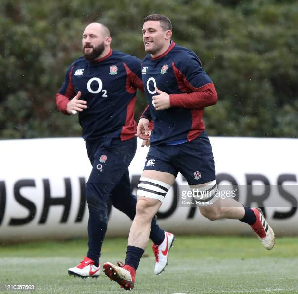 Mark Wilson and Joe Marler of England train during a training session ahead of their Guinness Six Nations match against Wales at Pennyhill Park on...