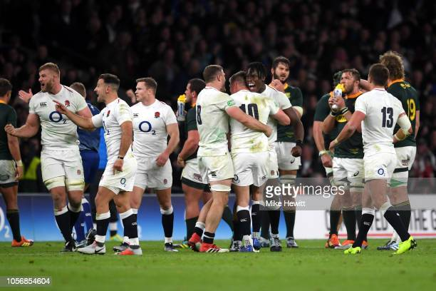 Mark Wilson and Maro Itoje celebrate with team mate Owen Farrell of England following victory in the Quilter International match between England and...