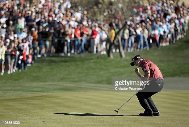Mark Wilson celebrates after making a birdie putt on the second playoff hole to win the Waste Management Phoenix Open at TPC Scottsdale on February 7...