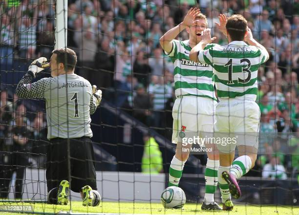 Mark Wilson of Celtic congratulates Shaun Maloney on scoring Celtic's forth goal lduring the Scottish Cup semi-final between Aberdeen and Celtic at...