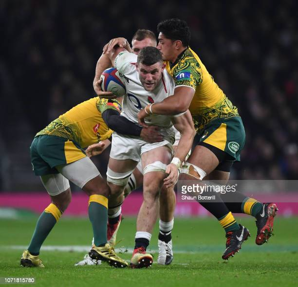 Mark Wilson of England breaks through the tackle of Pete Samu of Australia during the Quilter International match between England and Australia at...