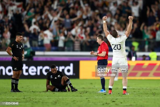 Mark Wilson of England celebrates at the final whistle while Richie Mo'unga and Sevu Reece of New Zealand look on in disappointment during the Rugby...