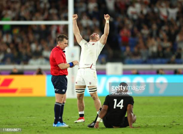 Mark Wilson of England celebrates the win while referee Nigel Owens and Sevu Reece of New Zealand look on during the Rugby World Cup 2019 SemiFinal...